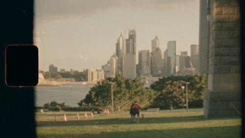 A Couple In A Park Overseeing Sydney City Skyline And The Opera House