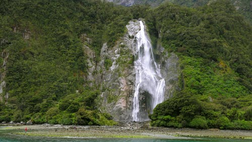 A Waterfalls From The Cliff Of A Mountain Forest