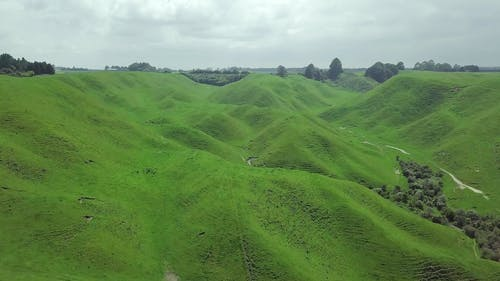 Ranges Of Hills Cover In Green Grass