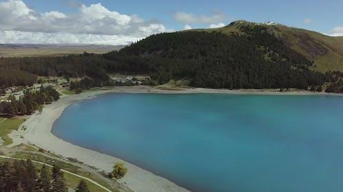 Lake Shore Of A Big Lake In Between Mountains