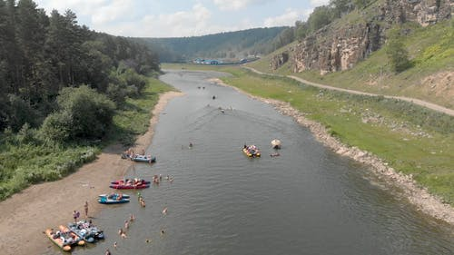 People  Boating And Kayaking On A River Valley