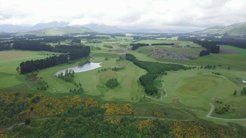 A Golf Course Built On A Large Open Grassland