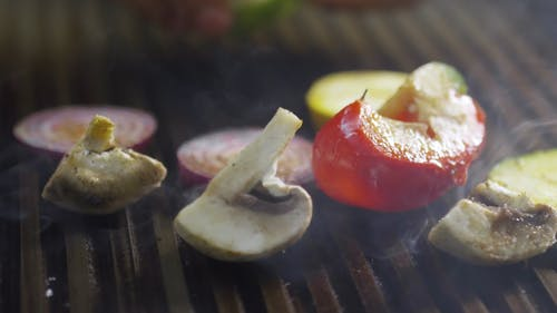 Grilling Sliced Mixed Vegetables On A Pan Grill