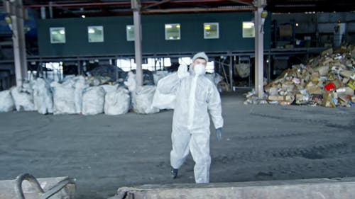 A Man Working In A Recycling Plant