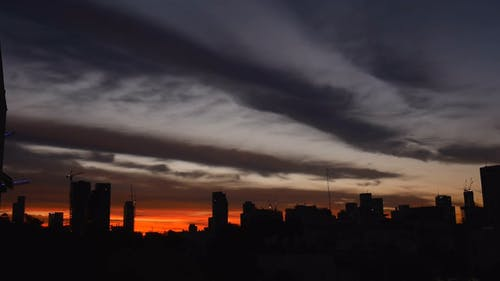 Clouds Formation Over A City At Sunrise
