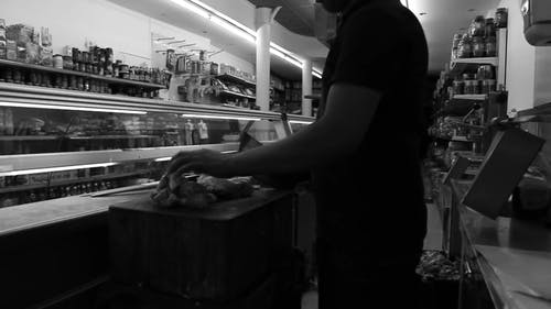 A Butcher Cuts Poultry Meat Into Small Pieces