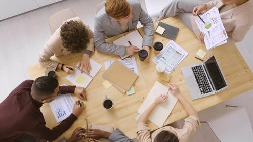 A Group Of People Brainstorming In A Business Meeting