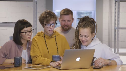 A Group Of People Have Their Eyes Focused On A Laptop Screen