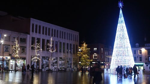 A Giant Lighted Christmas Tree In Display In Celebration Of The Christmas Season