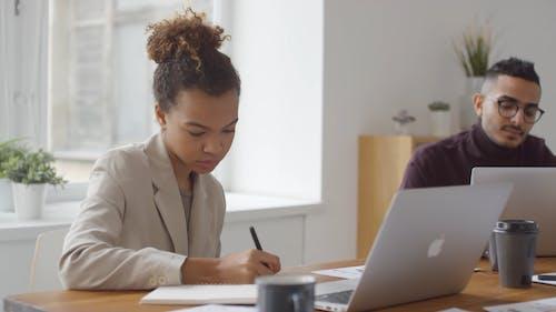 A Woman Asked A Man Regarding A Document About Work