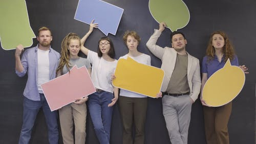 Group Of People Holding A Blank Statement Boards