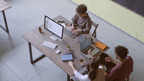 Group Of People Sitting Busy Working With Their Laptop