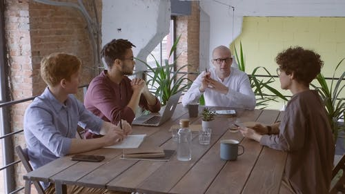 Group Of People Having Business Meeting In Office Space