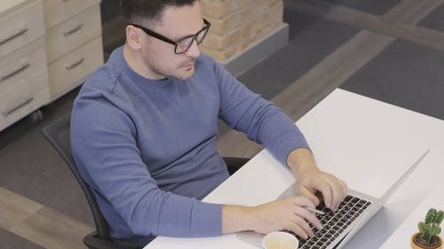 Man Having Coffee While Working In The Office