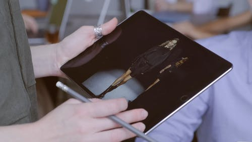A Person Looking at Fashion Wear On A Tablet