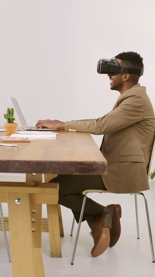 Man Playing With A Virtual Reality Headset