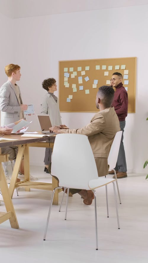 A Group Of People Having A Discussion In A Business Meeting