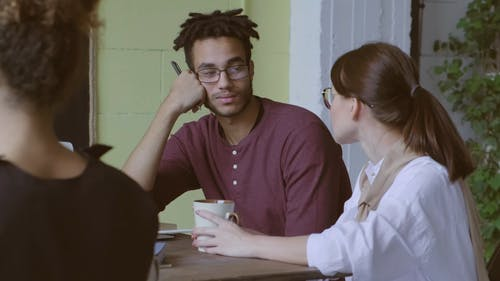 A Man And A Woman Talking In The Workplace While On Coffee Break