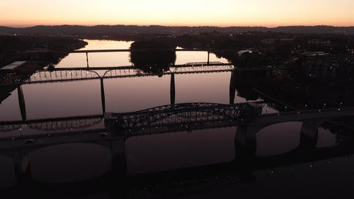 Aerial View Of Bridges On A River At Sunset