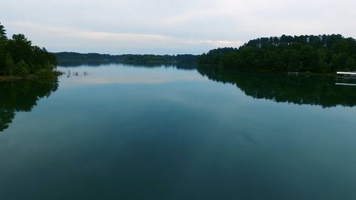 Drone Flying Over A Lake With A Smooth Surface