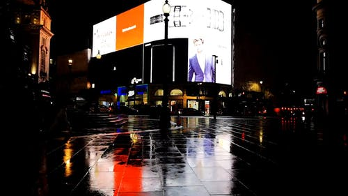 Electronic Billboard Lighting Up The Street In London At Night