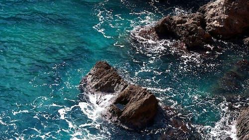 Waves Crashing To Rocks
