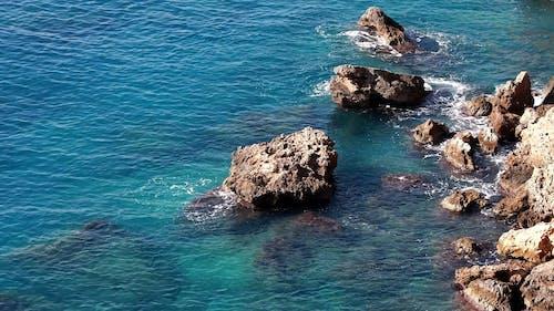 Natural Rocks Formation By The Seashore