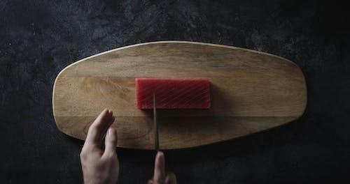 Person Slicing A Tuna