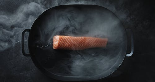 Salmon In A Pan With A Bit Of Water