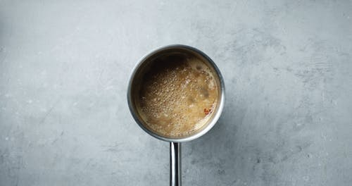 Placing The Ingredients On A Boiling Broth For A Soup Dish