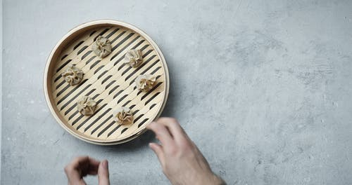 Setting Up Raw Dim Sum In A Bamboo Steamer For Cooking