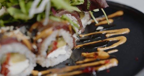 Serving Presentation For An Order Of Sushi Rolls