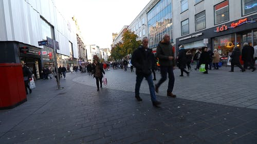 People Busy Walking In A Shopping Center Street