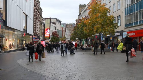 People Busy Walking On A Shopping Center