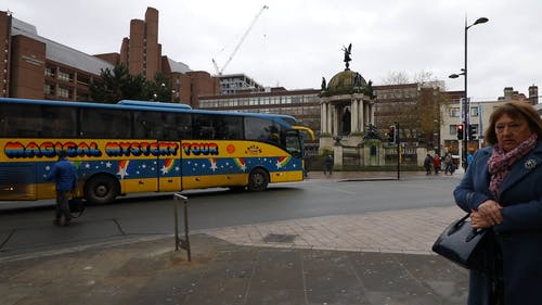 A Tour Bus Waiting For The Traffic Lights To Turn Green