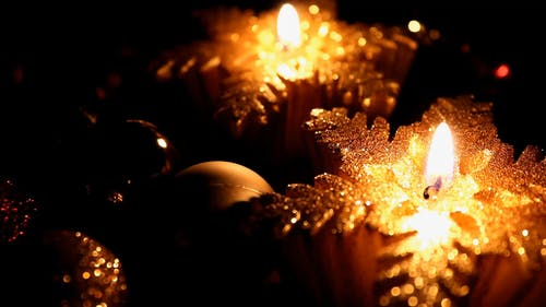Christmas Candles On Lit Providing Light In Darkness