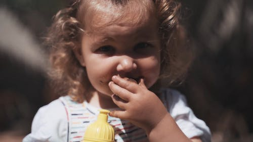 A Girl Eating A Muffin
