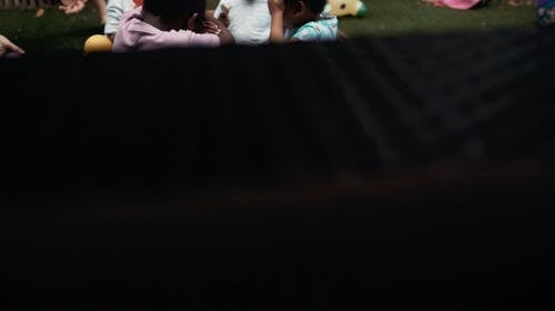 Man Playing Balls With The Children