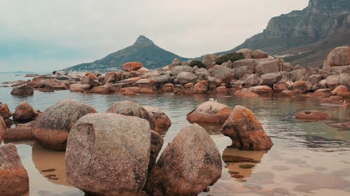 Boulders Of Rock Lying Along The Coastline Of The Sea In Cape Town, South Africa