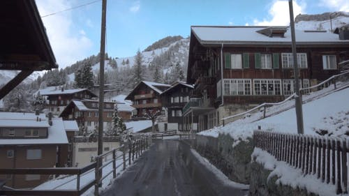 Houses With Snow Along The Road In Winter