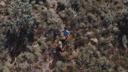 A Man Lifting A Woman In Their Hiking Trip