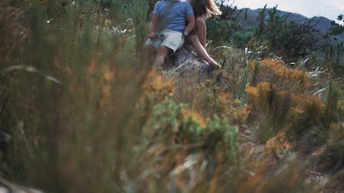Couple Sitting on a Boulder