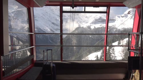 Riding Cable Cars To Reach The Mountain Ski Resort In Switzerland