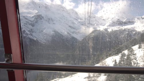 View From Cable Car Overlooking The Snow Covered Mountains