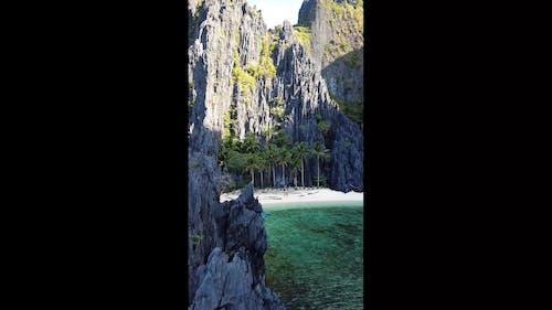 A Hidden White Beach Behind The Mountain Rocks