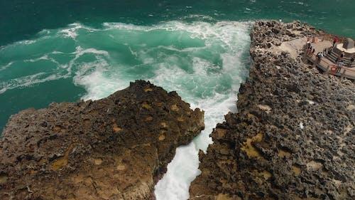 Waves Crashing on Rocks in Bali Island.