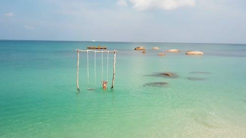 A Swing Built At Sea In A Beach