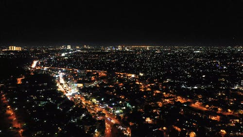 Aerial Footage Of A City Skyline At Night