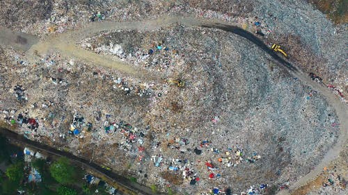 Drone Footage Of A Man Scavenging In A Dumpsite