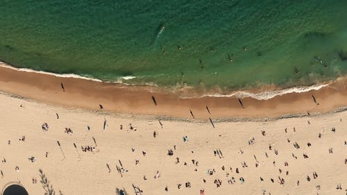 People Crowding A Beach During Summer